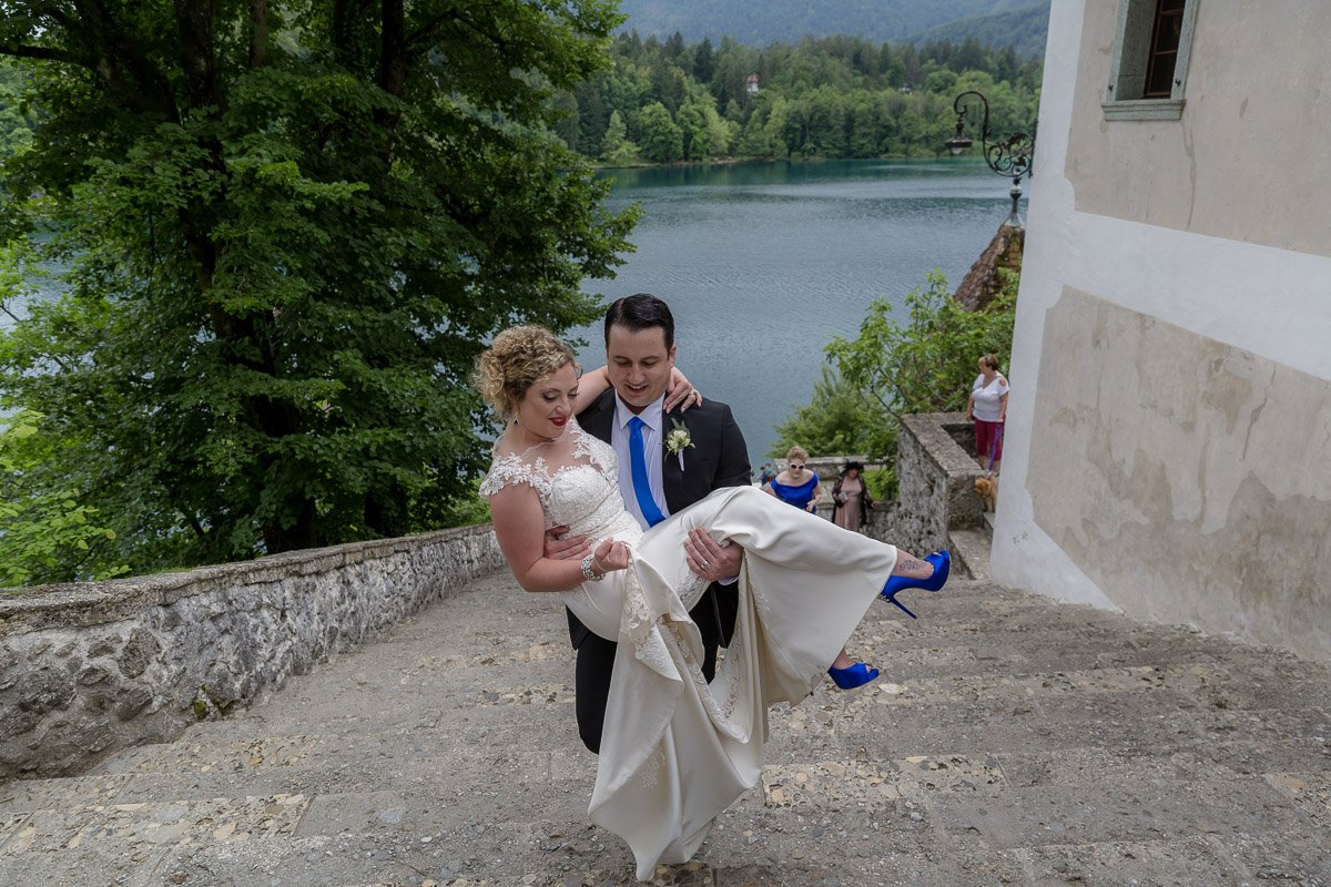 groom carrying the bride - lake bled